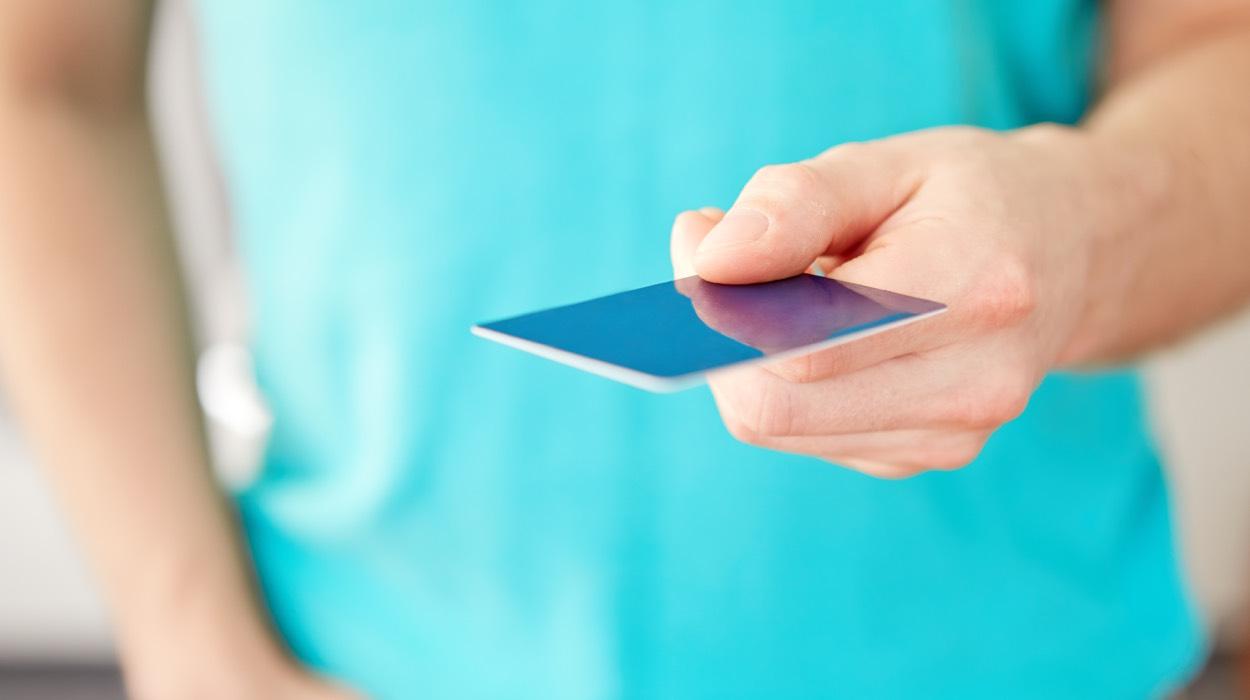man holding plastic card